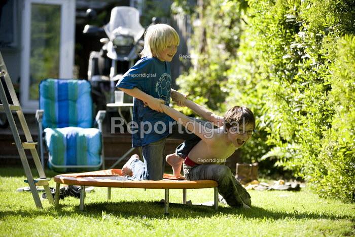 Boys wrestling in the garden. - John Harris - 2009-05-23