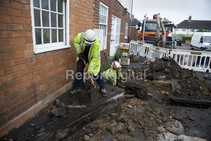 Contractors installing a new electricity main to a building with multiple occupancy. The have dug up the road and pavement to do so. - John Harris - 2009-05-13