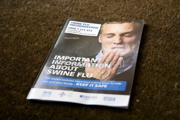 Government Swine flu information leaflet showing a man sneezing and spreading the virus. - John Harris - 2009-05-15