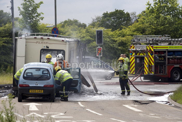 Fire service attend an incident in which a camper van has caught fire. Worcestershire. - John Harris - 2009-06-08
