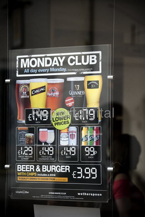 Advertisement for cheap alcoholic drinks in the window of a Weatherspoons. - John Harris - 2009-06-13