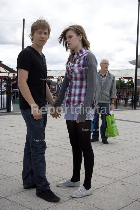 Teenagers holding hands Wednesbury town centre. - John Harris - 2009-07-18