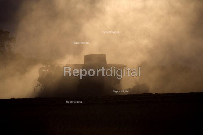 Combine harvester cutting wheat, Rutland. - John Harris - 2009-08-23
