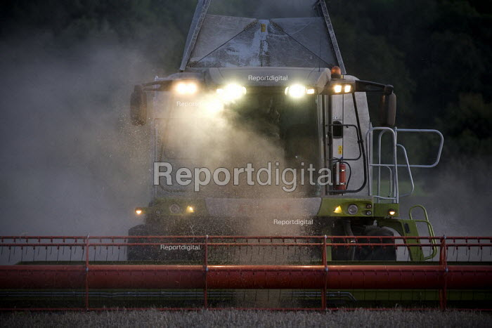Combine harvester cutting wheat, Rutland. - John Harris - 2009-08-21