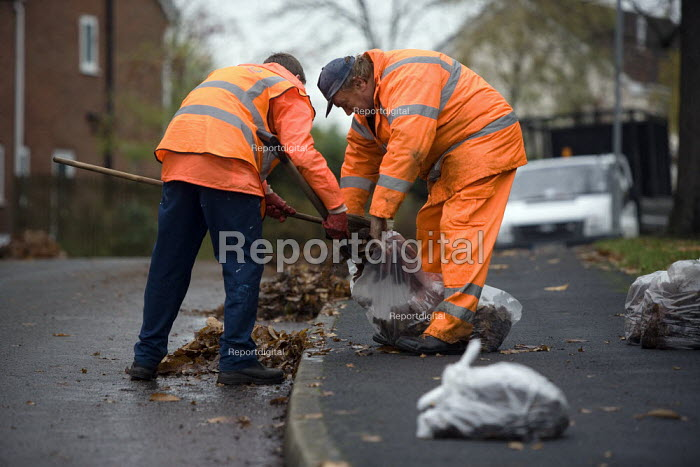 Council workers sweeping up and clearing autumn leaves from the village streets, Quorn, Leicestershire. - John Harris - 2009-10-13