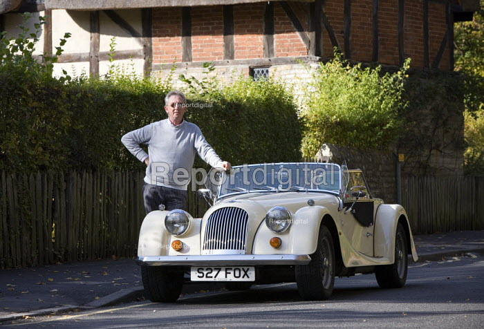 Man with his Morgan sports car bought for his retirement. - John Harris - 2009-10-16