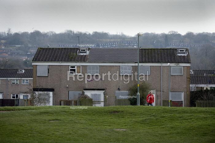A woman passes derelict houses on a housing estate in Birmingham. - John Harris - 2010-01-27