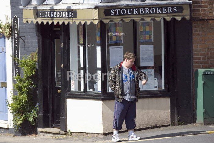 A youth waiting outside a Stockbrokers shop. - John Harris - 2010-05-20