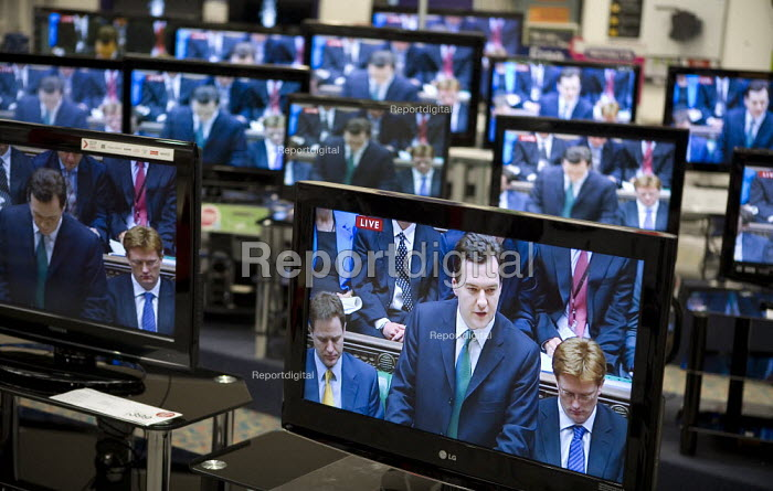 Budget speech to Parliament by George Osborne seen on televisons in a Currys store. - John Harris - 2010-06-22