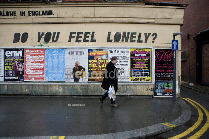 Do you feel lonely? 6.8 million people live alone in England. A man walking past graffiti in Liverpool - John Harris - 2011-05-15