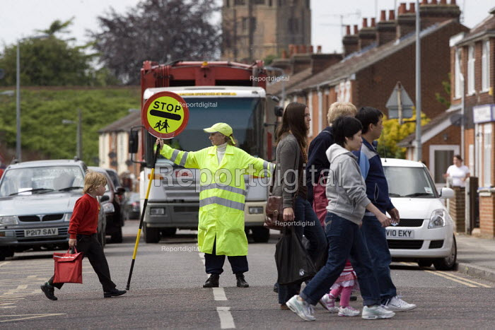 School crossing patrol officer with a Lollypop, helping parents and pupils to cross the road safely, Ipswich - John Harris - 2010-01-27