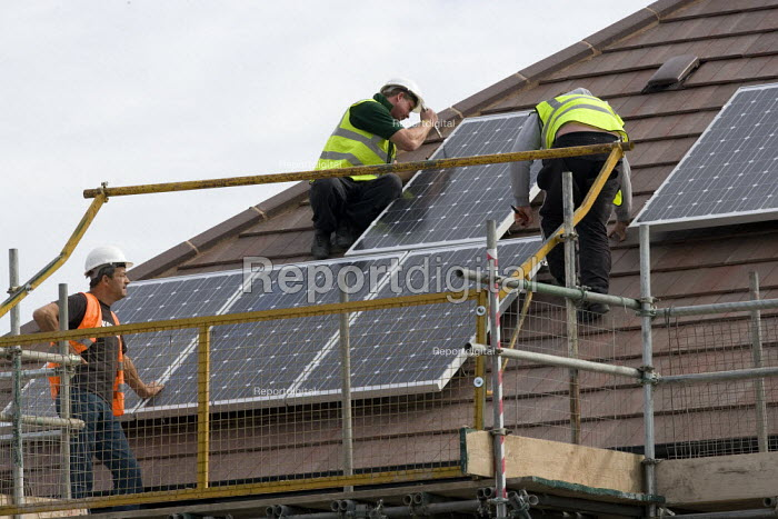 Fitting photovolvic panels to a roof. Workers housebuilding, Warwickshire. - John Harris - 2011-09-23