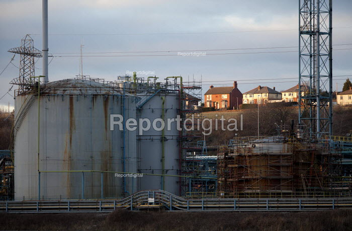 Houses overlooking the chemical works. Ineos manufactures chemicals including chlorine, chlorine-containing compounds including vinyl chloride, heavy chemicals including alkalis, and fluorine-containing compounds. Ineos Chemical works, Weston Point, Runcorn, Cheshire - John Harris - 2013-03-12