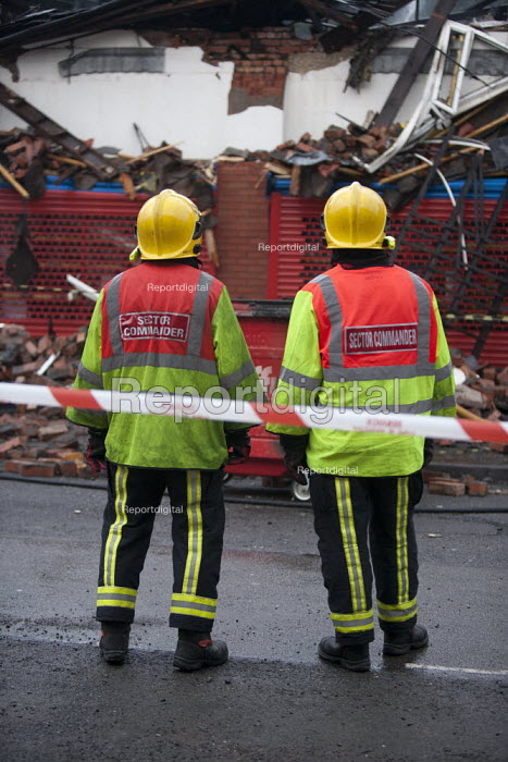 Red and white striped tape used to cordon off an area during an incident to protect the public. Sector Commanders in discussion. Fire and Rescue Service attending a fire, Birmingham - John Harris - 2013-03-27