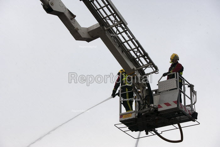 Firefighters spraying a jet of water from a hydraulic platform. Fire and Rescue Service attending a fire, Birmingham - John Harris - 2013-03-27