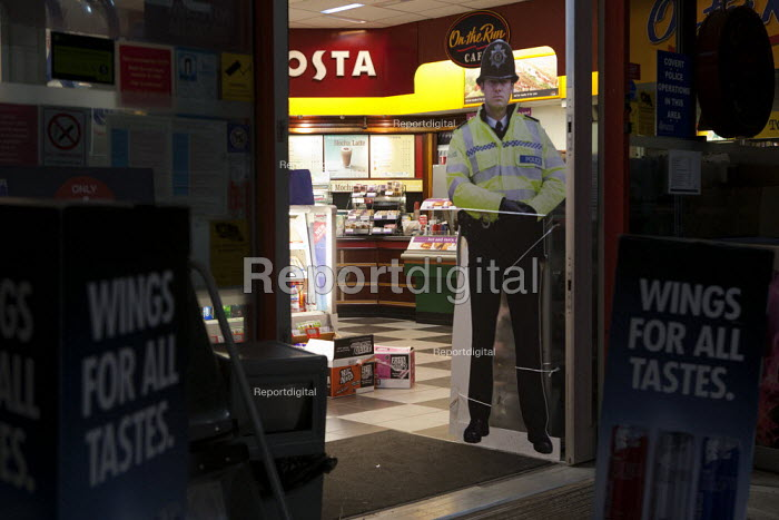 Cardboard cutout Policeman, intended to prevent crime and reduce the perception of fear of crime. They have been deployed in petrol stations to deter drivers from driving away without paying for their fuel, and also in shops to discourage shoplifting. Warwickshire - John Harris - 2013-04-06