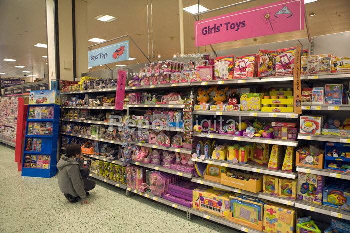 Gender stereotyping in a differentuated display of shelves of gender biased children's toys at Morrisons supermarket. Girl's toys (pink) Boy's toys (blue). - John Harris - 2012-05-05