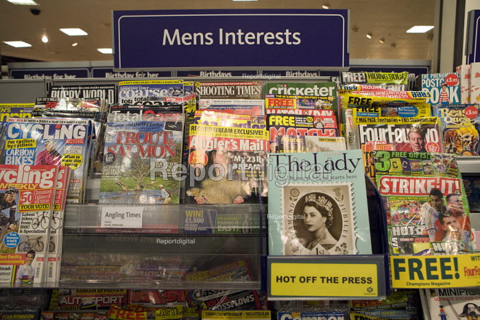 Gender stereotyping in a display of Mens Interests leisure magazines on a rack at Morrisons supermarket - sport, shooting, fishing, cycling cricket etc.. The Lady magazine is hot off the press. - John Harris - 2010-01-27
