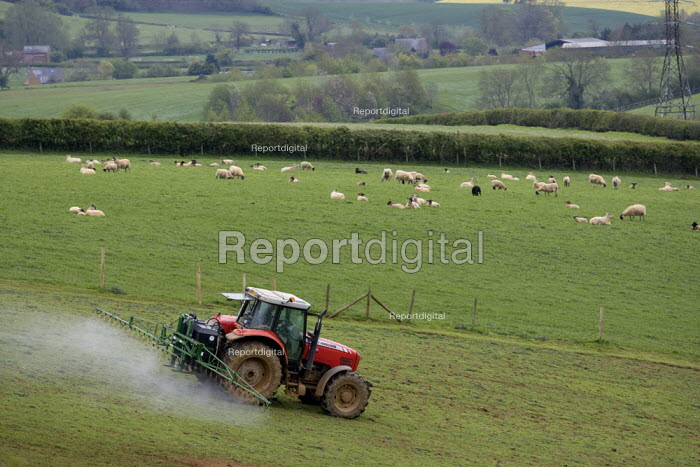 A farmworker crop spraying with a tractor and rig on a farm in Oxfordshire - John Harris - 2012-05-21
