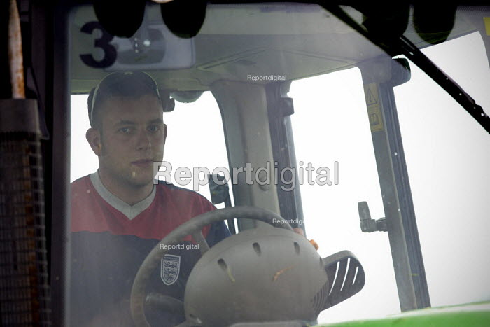 Tractor driver. Silage making on a farm, Wormleighton, Warwickshire - John Harris - 2012-05-22