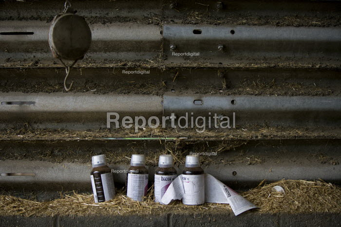 Bottles of concentrated liquid herbicide additive for the control of perennial broad-leaved weeds, a barn on a farm, Wormleighton, Warwickshire - John Harris - 2012-05-22