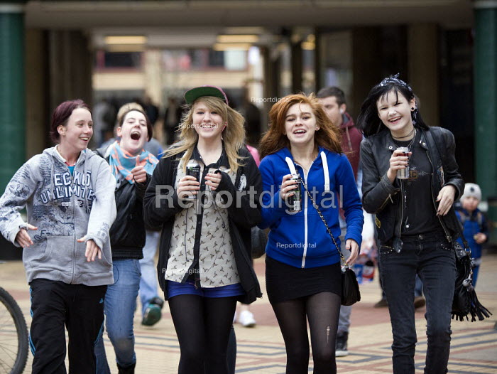 Teenage girls singing as they walk through the shopping precinct (drinking Monster energy drinks) Broadgate shopping precinct, Coventry - John Harris - 2012-11-17