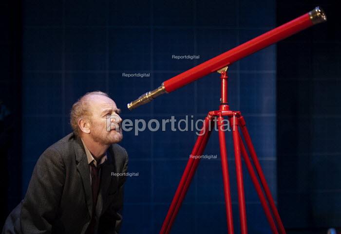 Ian McDiarmid as Galileo looking through his telescope in A Life of Galileo. RSC, Swan, Stratford-upon-Avon - John Harris - 2013-02-07