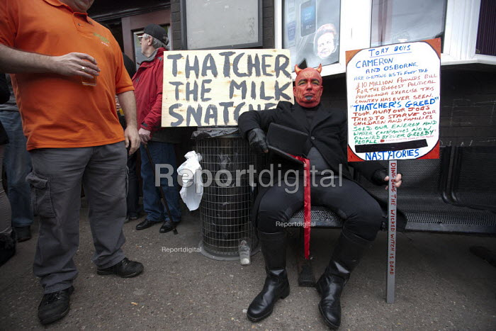 A devil funeral director mocking Thatcher the milk snatcher (referring to her policy when Education Secretary). Protest on the day of the funeral of Margaret Thatcher, Goldthorpe - a former pit village, South Yorkshire. - John Harris - 2013-04-17