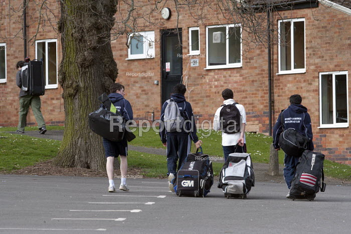 Cricket players walking with their kit bags back to their student accommodation after a Sunday cricket game, Warwick University - John Harris - 2013-04-21