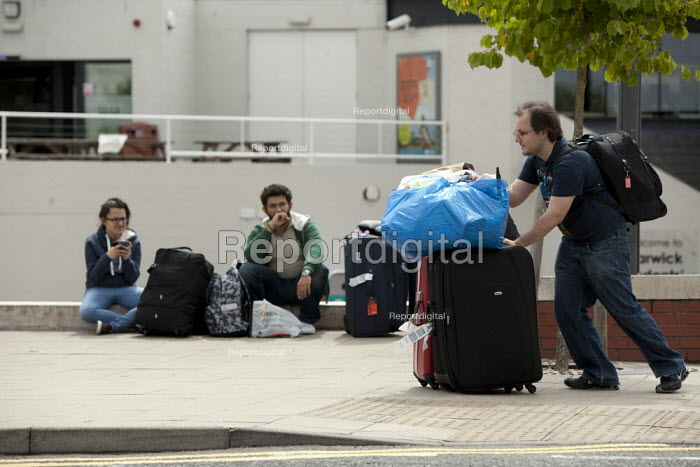 Students leaving Warwick University with their luggage as the break up at the end of the Summer term - John Harris - 2013-06-29