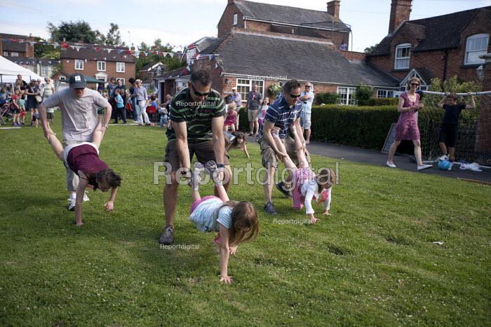 A wheelbarrow race, Alveston Summer Fete on the village green, Warwickshire - John Harris - 2013-06-29