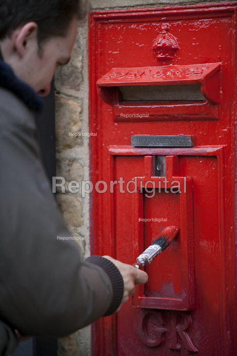 A man painting a disused rural Postbox, Enstone, Oxfordshire - John Harris - 2013-10-20