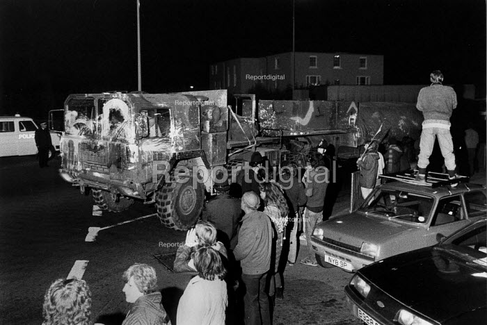 Cruisewatch protest as a speeding USAF cruise missile launcher convoy returns to RAF Greenham Common through Newbury in the early hours from deployment on Salisbury Plain 1983 - John Harris - 1983-12-11