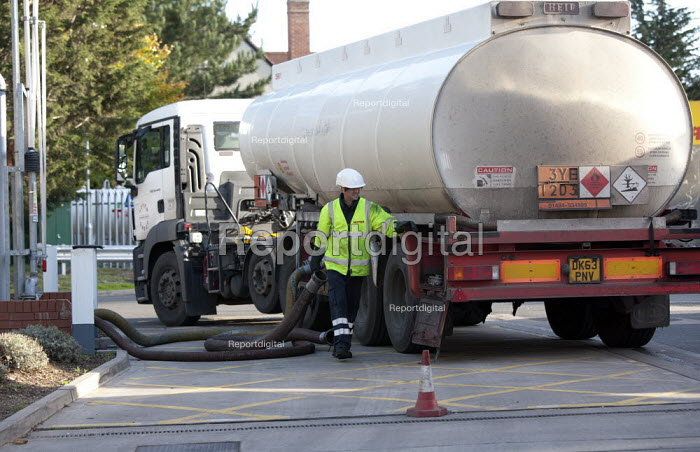 Tanker driver delivering fuel to a Shell petrol station. - John Harris - 2013-11-03