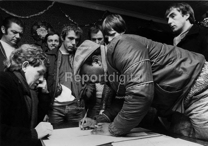 A miner signing up for picket duty, Armthorpe miners welfare, Doncaster - John Harris - 1984-12-13