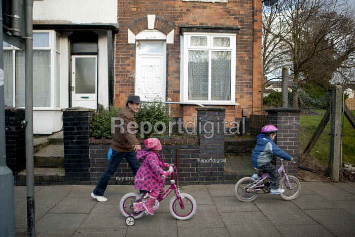 A parent and children, James Turner Street, featured in the Channel 4 program Benefits Street a tv series which has demonised the residents as the undeserving poor, Winson Green, Birmingham - John Harris - 2014-01-23