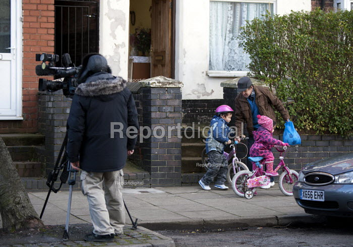 A parent and children, whilst an ITV camera crew film James Turner Street, featured in the Channel 4 program Benefits Street a tv series which has demonised the residents as the undeserving poor, Winson Green, Birmingham - John Harris - 2014-01-23