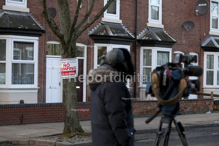 No Dumping litter sign and an ITV camera crew filming James Turner Street, featured in the Channel 4 program Benefits Street a tv series which has demonised the residents as the undeserving poor, Winson Green, Birmingham - John Harris - 2014-01-23