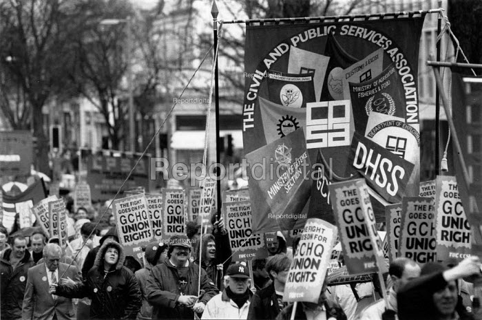 Over 10,000 marched through Cheltenham on the 6th anniversary of the ban on trades union membership GCHQ for which members were then sacked. GCHQ Trade unions, Cheltenham - John Harris - 1990-01-27