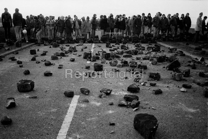 Pickets confront police trying to get a scab into Woolley colliery, Woolley Edge, Yorkshire. The scab decided to stop going in. The pickets had filled the road with stones. - John Harris - 1984-10-16