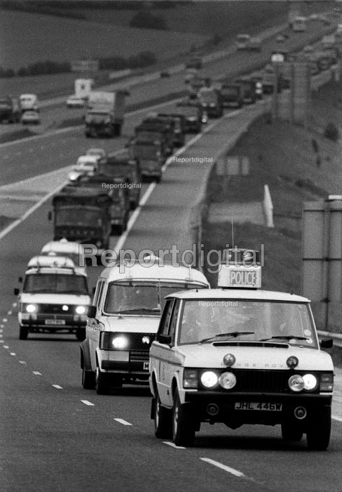 Police leading a convoy of lorries bring coke from Orgreave Coking works in Yorkshire to BSC Scunthorpe steelworks. M1 Yorkshire - John Harris - 1984-05-25