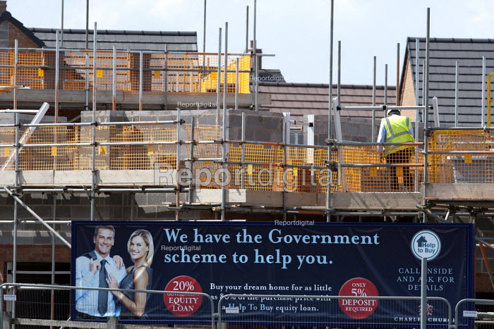 We have a government scheme to help you, help to buy mortgage equity loan sign on a building site with new houses, Telford. - John Harris - 2014-05-19