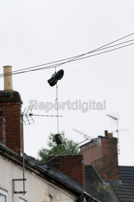 A pair of trainers hanging from a phone line, Humberstone, Leicester - John Harris - 2014-06-04