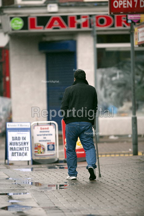 A disabled man walking along the pavement, Humberstone, Leicester - John Harris - 2014-06-04