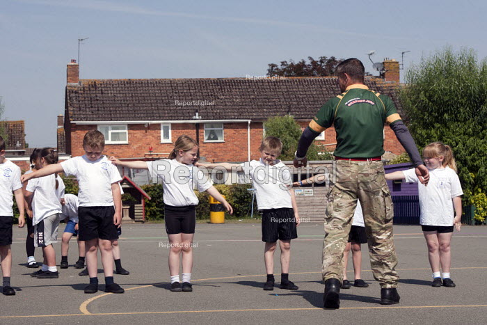 Commando Joe; wake and shake and initiative to improve attendance and punctuality by working with an ex member of the armed forces, lining up in the playing field, St Richard's C E First School, Evesham - John Harris - 2014-07-02