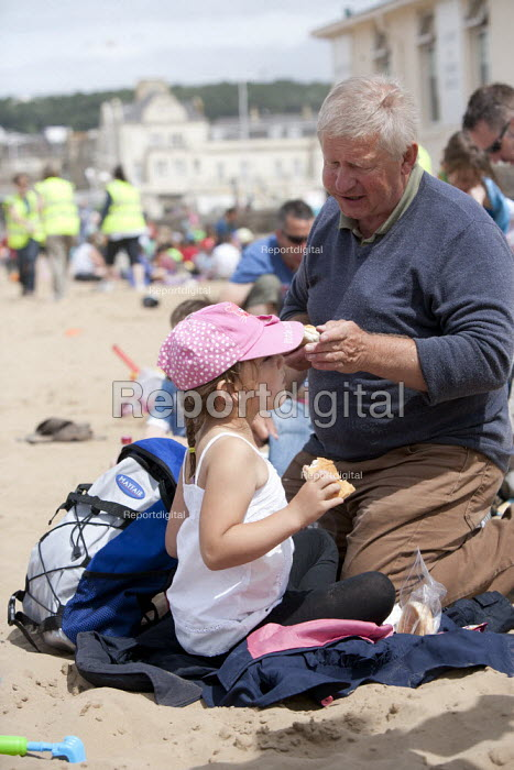 Grandfather and grandaughter, St Richards C E First School trip to the seaside, Weston Super Mare, Somerset - John Harris - 2014-07-04