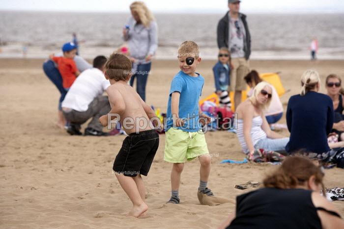 Playing pirates, St Richards C E First School trip to the seaside, Weston Super Mare, Somerset - John Harris - 2014-07-04