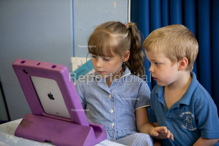 Pupils using an Ipad computer, St Richard's C E First School, Evesham - John Harris - 2014-07-02