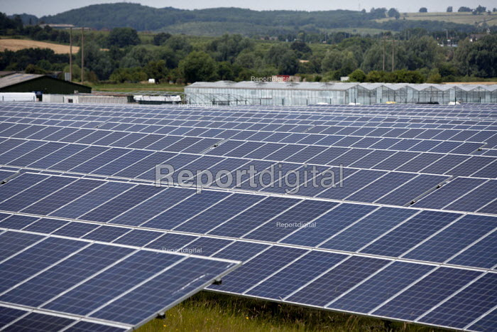 Ground mounted Photovoltaic panels at a Solar energy park on a nursery in the Vale of Evesham, Worcestershire - John Harris - 2014-07-02
