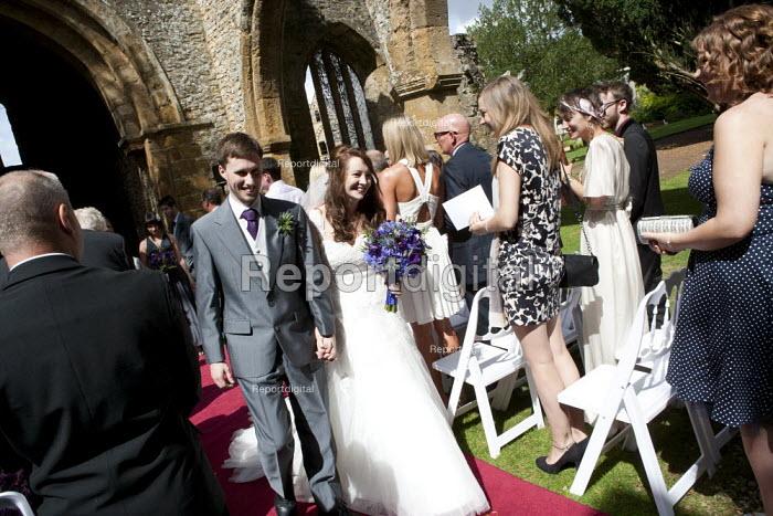 Bride and Groom, wedding in the ruins of a church. Warwickshire - John Harris - 2014-08-07